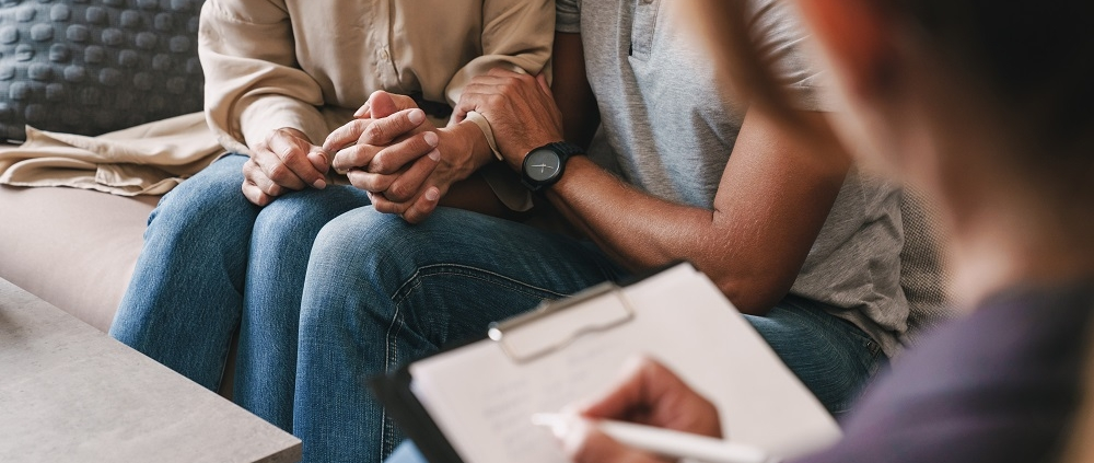 Patient couple having psychologist consulting on marriage counselling